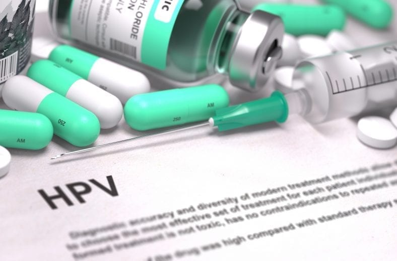 Diagnosis - HPV - Human Papilloma Virus. Medical Report with Composition of Medicaments - Light Green Pills, Injections and Syringe. Blurred Background with Selective Focus.